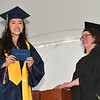 """CARL RUSSO/staff photo Andover's Valedictorian, Emily Chen receives her diploma from Susan McCready, Andover School Committee Chair. Andover High School held its 161Commencement Monday afternoon.  <br /> <br /> In the last four years the 445 members of the Class of 2021 have witnessed the Merrimack Valley gas explosions, learned during a once-in-a-century global pandemic, and, for their last lesson, the Golden Warriors overcame 92 degree heat.<br /> <br /> """"The past four years have been anything other than normal, yet as a class we have faced it with resilience,"""" said Caroline Chen, who read the class essay. """"COVID put a pause on traditions, but certainly didn't stop us."""" 6/7/2021"""