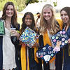 """CARL RUSSO/staff photo Andover graduates, from left, Natalie Guterman, Bipasha Ray, Molly Pritchard and Olivia Ventre show off their decorated motar boards. <br /> <br /> Andover graduates, their families, friends and teachers took refuge from the hot sun under the large tent for the high school's 161st. Commencement  ceremony Monday afternoon.<br /> <br /> In the last four years the 445 members of the Class of 2021 have witnessed the Merrimack Valley gas explosions, learned during a once-in-a-century global pandemic, and, for their last lesson, the Golden Warriors overcame 92 degree heat.<br /> <br /> """"The past four years have been anything other than normal, yet as a class we have faced it with resilience,"""" said Caroline Chen, who read the class essay. """"COVID put a pause on traditions, but certainly didn't stop us."""" 6/7/2021"""