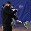 TIM JEAN/Staff photo<br /> <br /> Zachary Nigrelli, 13, swings his racket towards the ball as he practices the proper forehand technic during a Tennis Academy program held at South School.  3/15/21