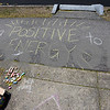 TIM JEAN/Staff photo<br /> <br /> Aya Murata, 49, of Andover, who is an associate director of college counseling at Philips Academy has been leaving positive messages in sidewalk chalk outside her house to help those add some pep into their step during the quarantine.  5/5/20
