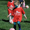 TIM JEAN/Staff photo<br /> <br /> Savannah Kramer, 4, learns how to dribble the ball during the Kickin' Kids Youth Soccer League at Andover's Recreation Park. The recreation league is made up of children ages 4-6 that learn basic soccer fundamentals over several weeks. Players will learn how to pass, shoot, dribble, and play together as a team.   5/1/21
