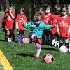 TIM JEAN/Staff photo<br /> <br /> Everly Mercer, 4, kicks the ball towards the goal during the Kickin' Kids Youth Soccer League at Andover's Recreation Park. The recreation league is made up of children ages 4-6 that learn basic soccer fundamentals over several weeks. Players will learn how to pass, shoot, dribble, and play together as a team.   5/1/21