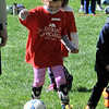 TIM JEAN/Staff photo<br /> <br /> Georgia Forina, 5, dribbles the ball while playing a game during the Kickin' Kids Youth Soccer League at Andover's Recreation Park. The recreation league is made up of children ages 4-6 that learn basic soccer fundamentals over several weeks. Players will learn how to pass, shoot, dribble, and play together as a team.   5/1/21