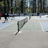 TIM JEAN/Staff photo<br /> <br /> About twenty participants from all across the Merrimack Valley warm up before the start of a adult Pickleball Tournament at Andover's Recreation Park.    5/1/21