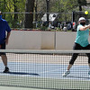 TIM JEAN/Staff photo<br /> <br /> Robert Theroux, left, of Hudson, NH., and Laura Heart, of Dracut, return a volley during a mixed doubles match of an adult Pickleball Tournament at Andover's Recreation Park.    5/1/21