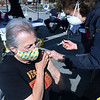 "CARL RUSSO/staff photo. Rosemarie Webb of Andover gets her flu shot from Maureen Baker R.N. Approximately 280 people by appointment received their flu shots on Wednesday, October 7.     <br /> <br /> The Andover Health Division Department offered two ""High-Dose"" Flu Clinics for Seniors, 65 yrs. and older, at the Bancroft Elementary School, on Wednesday, October 7th and Wednesday, October 14th, from 9 a.m. to 12 noon, by appointment only. 10/7/2020"
