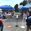 "CARL RUSSO/staff photo. Volunteer Jan Gifun, left of Andover directs a woman to  one of the tents for her flu shot. Approximately 280 people by appointment received their flu shots on Wednesday, October 7.      <br /> <br /> The Andover Health Division Department offered two ""High-Dose"" Flu Clinics for Seniors, 65 yrs. and older, at the Bancroft Elementary School, on Wednesday, October 7th and Wednesday, October 14th, from 9 a.m. to 12 noon, by appointment only. 10/7/2020"