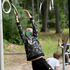 TIM JEAN/Staff photo<br /> <br /> Deacon Flanders, 6, reaches for the next ring while playing in the playground area during a summer camp program run by Andover Recreation Department held at Recreation Park.    8/26/20