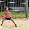 TIM JEAN/Staff photo<br /> <br /> Ava Venezia, 6, swings at the ball for a hit while playing a whiffle ball game during a summer camp program run by Andover Recreation Department held at Recreation Park.    8/26/20