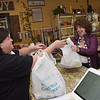 TIM JEAN/Staff photo  <br /> <br /> Rig a Tony's owner Lisa DeSisto, left, helps Diane Carpenter of Windham with her order. The Italian take-out now has a restaurant in Windham.     4/1/20
