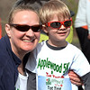 CARL RUSSO/Staff photo. Jennifer Kassing of Chester and her son Reese, 3 wear their shades as the sun finally comes out. Applewood Learning Center, a non-profit childcare center in the Derry/Londonderry area, held their annual Tot Trot and 5K race fundraiser at the Moose Hill School in Londonderry Saturday morning. 4/28/2018