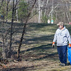 AMANDA SABGA/Staff photo<br /> <br /> Darrell Amell, of Empsom, looks for trash as he walks during Londonderry Trailways' annual clean up along the Londonderry Rail Trail.<br /> <br /> 4/21/17