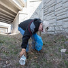 AMANDA SABGA/Staff photo<br /> <br /> Lee Coffman, of Londonderry, reaches for a cup during Londonderry Trailways' annual clean up along the Londonderry Rail Trail.<br /> <br /> 4/21/17