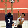 CARL RUSSO/Staff photo. Pinkerton's Tyler Behsman spikes the ball over the net as Lawrence's Wilbert Minier reaches to block. Lawrence high defeated Pinkerton Academy in boys volleyball action Saturday afternoon. 4/28/2018