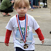 CARL RUSSO/Staff photo. Joshua Currie, 1 of Chester shows off his 3rd. place medal. Applewood Learning Center, a non-profit childcare center in the Derry/Londonderry area, held their annual Tot Trot and 5K race fundraiser at the Moose Hill School in Londonderry Saturday morning. 4/28/2018
