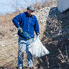 AMANDA SABGA/Staff photo<br /> <br /> Mike Eaton, of Londonderry, helps clear trash during Londonderry Trailways' annual clean up along the Londonderry Rail Trail.<br /> <br /> 4/21/17