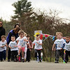 CARL RUSSO/Staff photo. Nora White, 4 of Derry sprints in front of the boys. Applewood Learning Center, a non-profit childcare center in the Derry/Londonderry area, held their annual Tot Trot and 5K race fundraiser at the Moose Hill School in Londonderry Saturday morning. 4/28/2018