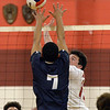 CARL RUSSO/Staff photo. Pinkerton's captain, Sean Galusha fights for the ball at the net against Lawrence's Wilbert Minier. Lawrence high defeated Pinkerton Academy in boys volleyball action Saturday afternoon. 4/28/2018