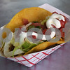 TIM JEAN/Staff photo<br /> <br /> A beef taco made to order for a customer at B's Tacos and More in Londonderry. Ken Spilman, of Derry, has expanded his business from a small trailer parked at the BP services station on Route 102 in Londonderry that also includes a food truck. 7/31/18