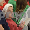 TIM JEAN/Staff photo<br /> <br /> Cooper Fowler, 10, holds the sheet music next to his best friend Dylan Nadeau, 9, left, as they sing in schools chorus during the Winter Wonderland celebration at Matthew Thornton Elementary School in Londonderry. 12/1/18