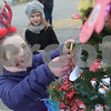 TIM JEAN/Staff photo<br /> <br /> Katy Parsons, left, adds her colored mitten to the Girl Scout Troop 10182 Christmas tree as her friend Emily Allen looks on during the Windham Tree Lighting celebration in front of the Town Hall and Town Common Saturday evening.  12/1/18