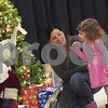 TIM JEAN/Staff photo<br /> <br /> Elizabeth Cashman of Londonderry, holds her daughter Faith, 2, who is a little shy seeing Santa during the Winter Wonderland celebration at Matthew Thornton Elementary School in Londonderry. 12/1/18