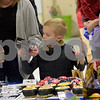 TIM JEAN/Staff photo<br /> <br /> Tracey Sabin, of Londonderry, helps her son Logan, 7, pick out a toy gift in the secret shop during the Winter Wonderland celebration at Matthew Thornton Elementary School in Londonderry. 12/1/18