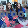 TIM JEAN/Staff photo<br /> <br /> Members of the Windham's Dance Connection from left to right, Skyler Eagan, Sara Watanabe, and Venessa Figueroa sell tickets for the Helping Hands gift baskets during the Windham Tree Lighting in front of the Town Hall and Town Common.  12/1/18