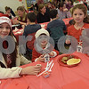 TIM JEAN/Staff photo<br /> <br /> Cristy Aviles of Londonderry, sits down to enjoy a pancake breakfast with her children Amixael, 3, and Rosie, 6, during the Winter Wonderland celebration at Matthew Thornton Elementary School in Londonderry. 12/1/18