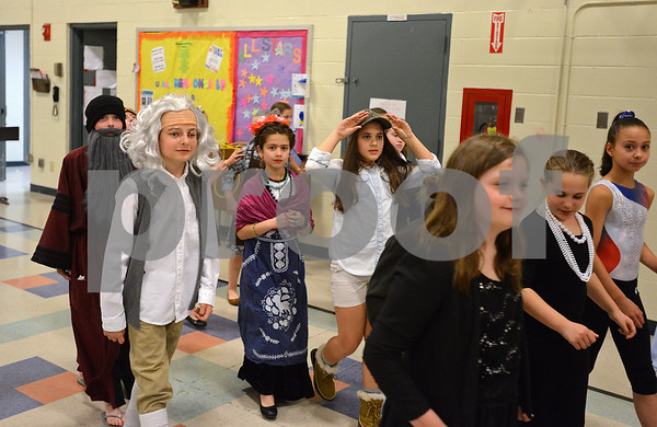 "RYAN HUTTON/ Staff photo<br /> Dressed as consequential people from history, students from the South Elementary School get ready for the  ""Images of Greatness"" night on Thursday."