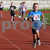 CARL RUSSO/staff photo. DERRY NEWS: Colton Boorda, 8 leads the pack in his race. Greater Derry Track Club hosted their 43rd. annual youth Fun Runs at Londonderry high last Monday. 7/02/2018