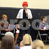 "RYAN HUTTON/ Staff photo<br /> Alex Nalen describes the life of Jacque Cousteau at the South Elementary School's ""Images of Greatness"" night where students dress up as consequential people from history."