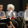 "RYAN HUTTON/ Staff photo<br /> Tucker Lindquist, center, adjusts his Albert Einstein mustache at the South Elementary School's ""Images of Greatness"" night where students dress up as consequential people from history."