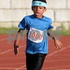 CARL RUSSO/staff photo. DERRY NEWS: Lincoln Desrochers, 6 gives his all in his race. Greater Derry Track Club hosted their 43rd. annual youth Fun Runs at Londonderry high last Monday. 7/02/2018