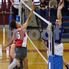 CARL RUSSO/Staff photo. Pinkerton's Tyler Behsman tips the ball over the net as Londonderry's Cameron Donnovan defends in volleyball action. 5/03/2018