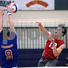 CARL RUSSO/Staff photo. Pinkerton's Hunter Hazard spikes the ball over the net as Londonderry's Logan Agrella defends in volleyball action. 5/03/2018