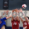 CARL RUSSO/Staff photo. Pinkerton's Sean Galusha, left and Hunter Hazard defend as Londonderry's James Buttafuoco spikes the ball in volleyball action. 5/03/2018