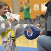 TIM JEAN/Staff photo<br /> <br /> Jack Corbett, 6, of Auburn, takes part in the martial arts Kick a Thon to support cancer patients at West Running Brook Middle School. The event was organized by Tim Barchard Professional Martial Arts Academy in Derry.  11/3/18