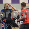 TIM JEAN/Staff photo<br /> <br /> Yolanda Logan, of Derry, takes part in the martial arts Kick a Thon to support cancer patients at West Running Brook Middle School. The event was organized by Tim Barchard Professional Martial Arts Academy in Derry.  11/3/18