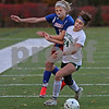 MIKE SPRINGER/Staff photo<br /> Londonderry's Gillian Vilela, left, competes for the ball with Erin Flurey of Manchester Central during New Hampshire Division 1 girls varsity soccer finals Sunday at Stellos Stadium in Nashua.<br /> 11/4/2018