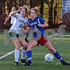 MIKE SPRINGER/Staff photo<br /> Londonderry's Samantha LeClair, right, competes for the ball with Emily Greenwood of Manchester Central during New Hampshire Division 1 girls varsity soccer finals Sunday at Stellos Stadium in Nashua.<br /> 11/4/2018