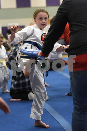 TIM JEAN/Staff photo<br /> <br /> Alysa Shanahan, 8, of Plaistow, takes part in the martial arts Kick a Thon to support cancer patients at West Running Brook Middle School. The event was organized by Tim Barchard Professional Martial Arts Academy in Derry.  11/3/18