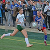 MIKE SPRINGER/Staff photo<br /> Londonderry's Ashley Manor, right, kicks the ball past Lindsay LeBlond of Manchester Central during New Hampshire Division 1 girls varsity soccer finals Sunday at Stellos Stadium in Nashua.<br /> 11/4/2018