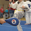 TIM JEAN/Staff photo<br /> <br /> Michael Layon, 6, of Derry, takes part in the martial arts Kick a Thon to support cancer patients at West Running Brook Middle School. The event was organized by Tim Barchard Professional Martial Arts Academy in Derry.  11/3/18