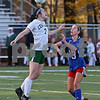 MIKE SPRINGER/Staff photo<br /> Manchester Central's Morgan Tremblay, left, hits the ball past Ashley Manor of Londonderry during New Hampshire Division 1 girls varsity soccer finals Sunday at Stellos Stadium in Nashua.<br /> 11/4/2018