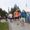 TIM JEAN/Staff photo<br /> <br /> Runners sprint out of the common at the start of the 1st annual 5k Baby Crawl race to benefit St. Gianna's Place. The race started and ended on the town common in Londonderry.  10/6/18