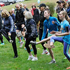 TIM JEAN/Staff photo<br /> <br /> Runners stretch and warm up before the start of the 1st annual 5k Baby Crawl race to benefit St. Gianna's Place. The race started and ended on the town common in Londonderry.  10/6/18