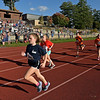 RYAN HUTTON/ Staff photo<br /> Caitlin Batts, left, from the South Elementary School, leads a pack of runners down the track during an elementary school cross country race at Londonderry High School on Wednesday.
