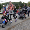 TIM JEAN/Staff photo<br /> <br /> Walkers and runners make their way onto the course for the 1st annual 5k Baby Crawl race to benefit St. Gianna's Place. The race started and ended on the town common in Londonderry.  10/6/18