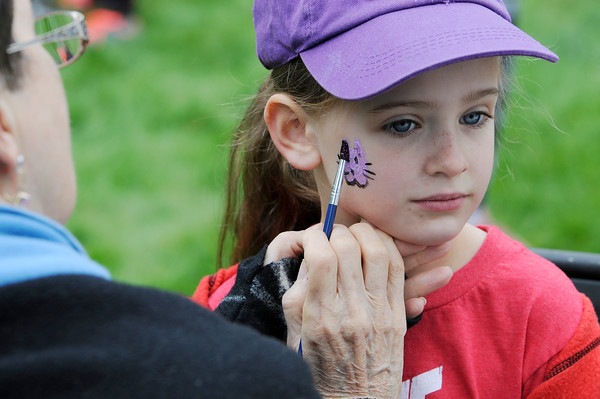 TIM JEAN/Staff photo<br /> <br /> Londonderry artist Barbra Scott, left, paints a kitty cat on the cheek of Gianna Aimone, 5, of Londonderry before the start of the 1st annual 5k Baby Crawl race to benefit St. Gianna's Place. The race started and ended on the town common in Londonderry.  10/6/18